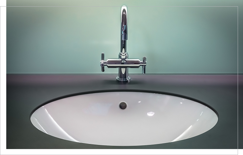Modern white sink with faucet